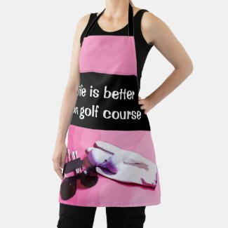 Golf ball with golf glove and tee on pink apron