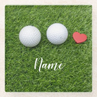 Golf ball with love on green grass for golfer glass coaster