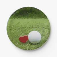 Golf ball with love shape on green grass paper plate