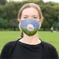 golf ball with message on red tee cloth face mask