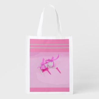 Golf ball with pink ribbon and tee on pink grocery bag