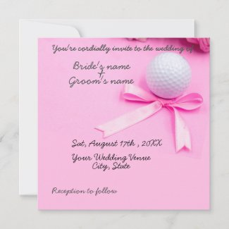 Golf ball with pink ribbon on pink background