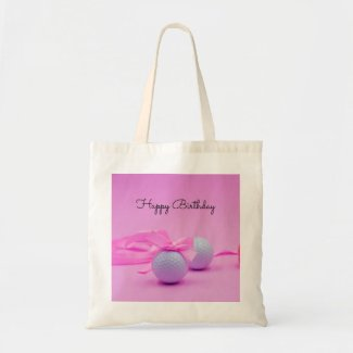 Golf ball with pink ribbon on pink background tote bag