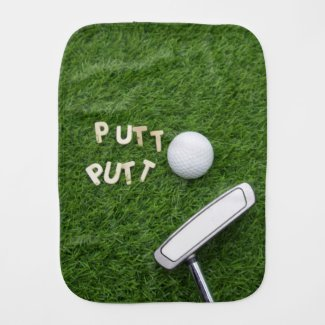 Golf ball with putter on green baby burb cloth