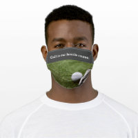 Golf ball with putter on green grass putting cloth face mask