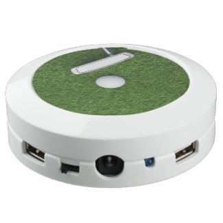 Golf ball with putter on green grass USB charging station