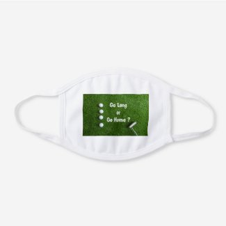 Golf ball with putter on green grass white cotton face mask