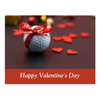 Golf ball with red ribbon with love red hearts postcard