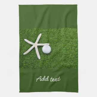 Golf ball with star fish on green for golfer Golf Kitchen Towel