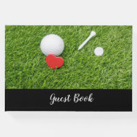 Golf ball with tee and red heart on green wedding guest book