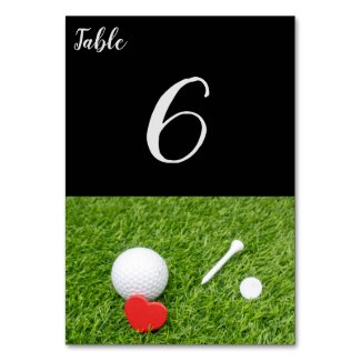 Golf ball with tee and red heart on green wedding table number