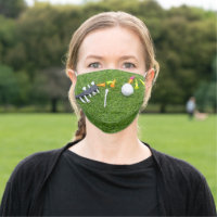Golf ball with tee on green cloth face mask
