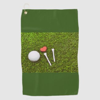 Golf ball with tees and heart love on green grass golf towel