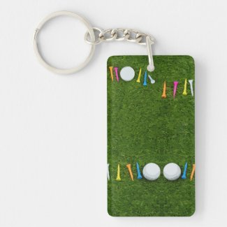 Golf ball with tees are on green grass keychain