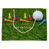 Golf ball with tees are on green grass large gift bag