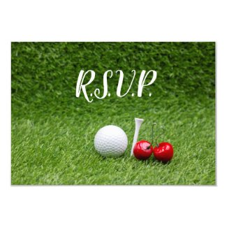 Golf ball with two cherries on green invitation