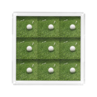 Golf balls and tee on green grass acrylic tray