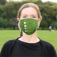 Golf balls are on green grass cloth face mask