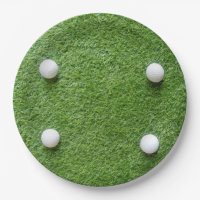 Golf balls are on green grass paper plate