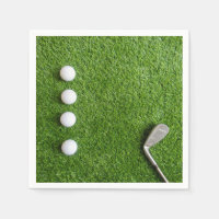 Golf balls are on green grass Paper Plate Napkin