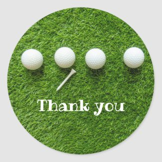 Golf balls are on green grass thank you classic round sticker