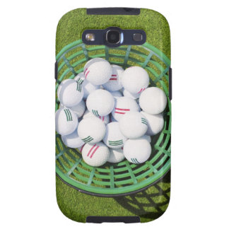 Golf balls in a basket sitting on short green samsung galaxy SIII covers