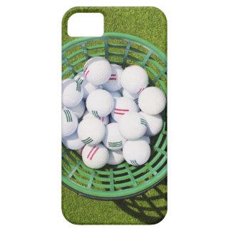 Golf balls in a basket sitting on short green iPhone SE/5/5s case