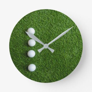 Golf balls in the row on green grass for Fathers Round Clock