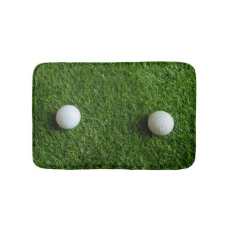 Golf balls on green grass bath mat