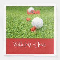 Golf balls with hearts on green grass with love paper dinner napkin