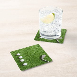 Golf balls with iron on green grass square paper coaster