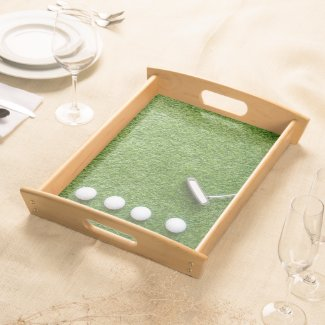 Golf balls with putter on green grass for golfer serving tray