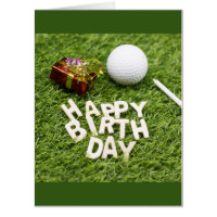Golf birthday with present and golf ball on green card