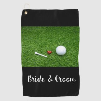 Golf bride and groom with golf ball and tee golf towel
