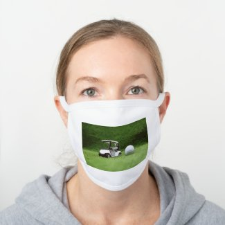 Golf cart buggy with golf ball on green grass white cotton face mask