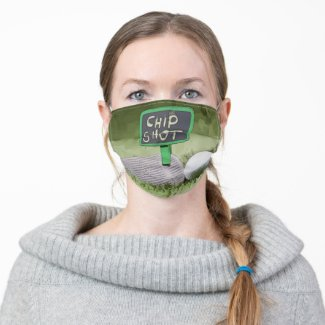 Golf chip shot with golf ball on green cloth face mask