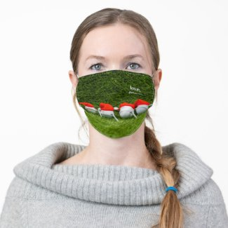 Golf Christmas with Santa hat on green grass Adult Cloth Face Mask