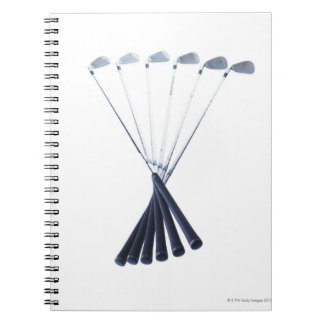 Golf clubs on white background notebook