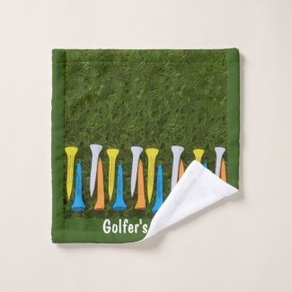Golf colorful tees are on green grass wash cloth