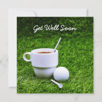 Golf get well soon with cup of tea and golf ball