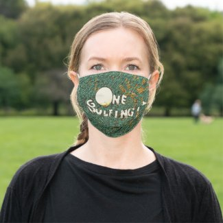Golf gone golfing with golf ball on green grass cloth face mask