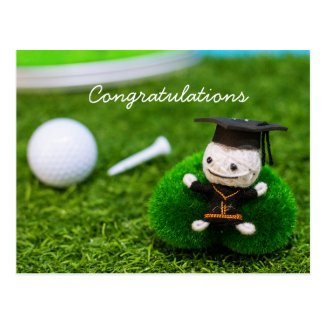Golf graduation with golf ball and tee on green postcard
