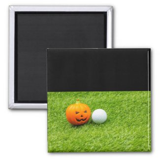 Golf Halloween with golf ball and pumpkin on green Magnet