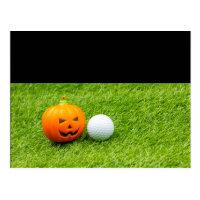 Golf Halloween with golf ball and pumpkin on green Postcard