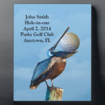 "Golf Hole-in-one Commemoration Customizable Plaque<br><div class=""desc"">Every golfer knows a hazardous lie when he sees one and this brown pelican with a golf ball in his mouth certainly meets the criteria. This is an image sure to bring a smile to all golfers. The Hole-in-one Commemoration information is a template that is easily customized. This is a...</div>"