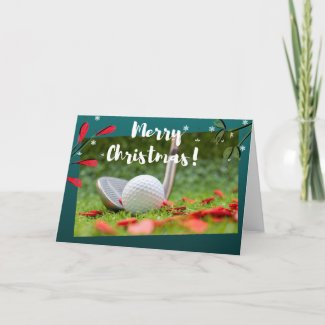 Golf iron and ball is on green Christmas Card