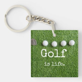 Golf is life with golf balls are on green grass keychain