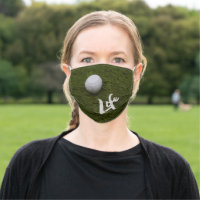 Golf life with golf ball on green grass cloth face mask