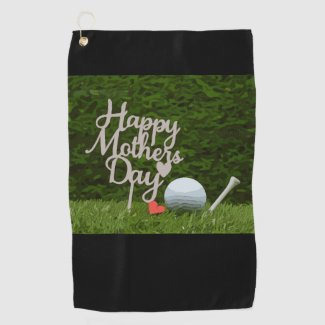 Golf mother's day with golf ball and tee on green golf towel