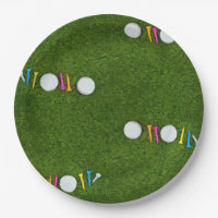 Golf napkin with golf ball and tees are on green paper plate